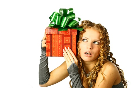 The girl with a gift in cheerfully box smiles new year Stock Photo - 10270763