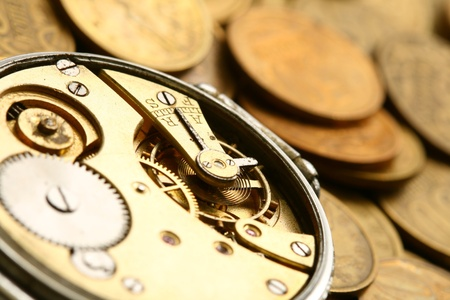 time machine: time is money coins and clock macro concet