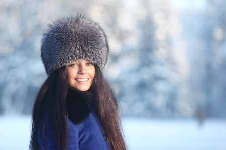 grin: winter women close up portrait in frost forest