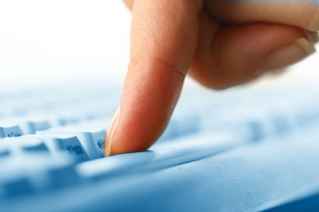 girl hands typing on keyboard macro close up photo