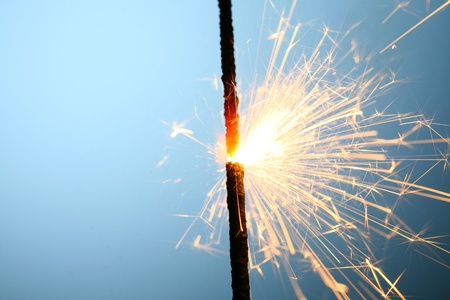 sparkler fire on blue macro background close up Stock Photo - 10303563