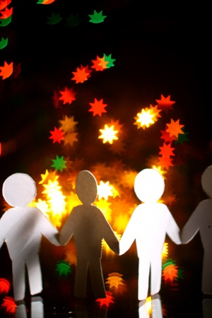 cooperative: paper team in bokeh star  world