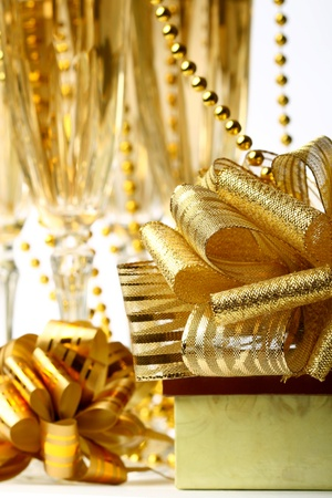 holiday card golden champagne and gift Stock Photo - 10316134