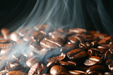 macro coffee beans in aroma smoke photo