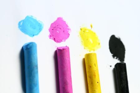 cmyk paint hand art on white paper photo
