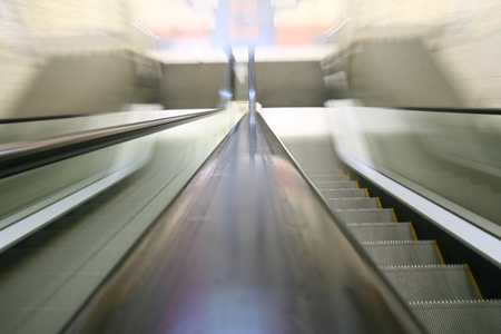 escalator transportation motion blured business background  photo