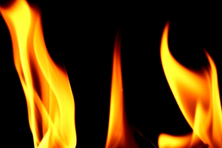 engulfed: fire on black close up abstract background