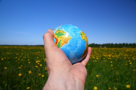 globe of planet earth in man hand photo