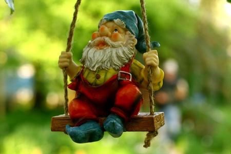 garden gnome: garden dwarf on green background Stock Photo