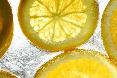frigid: orange in ice cube frozen background Stock Photo