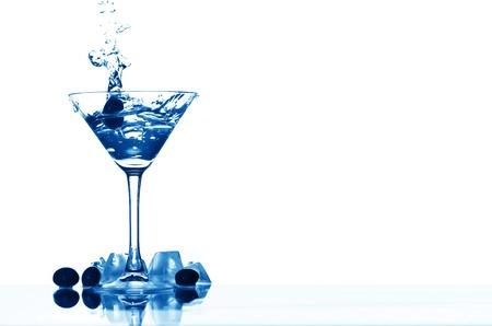 martini glass splash bar background Stock Photo - 10361878