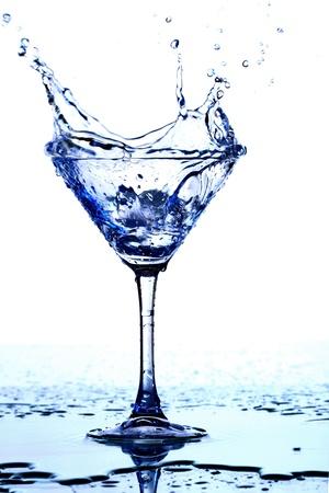 martini splash: alcohol splash macro close up Stock Photo