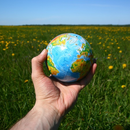the humanities landscape: globe of planet earth in man hand Stock Photo