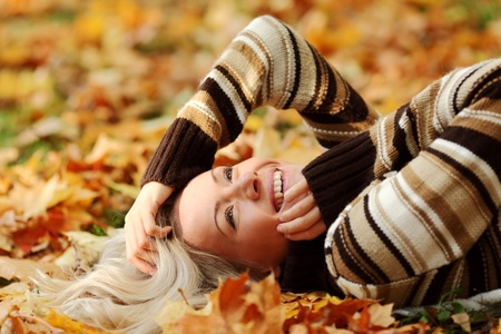 woman portret in autumn leaf close up Stock Photo - 10435818