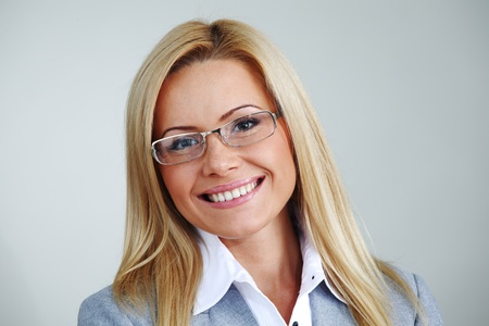business woman in glasses on gray background Stock Photo - 10435704