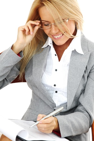 business woman hold a folder of papers  and write Stock Photo - 10435934