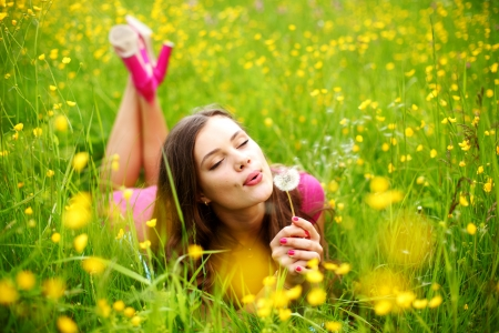 summer woman blow on dandelion Stock Photo - 10435852