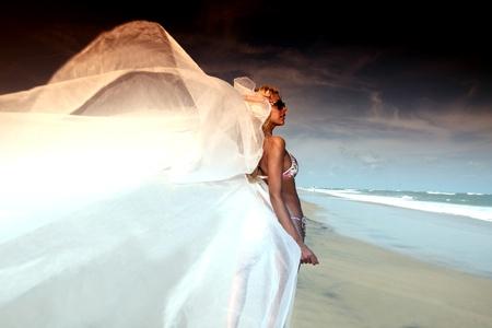 bride vacation on ocean coast photo