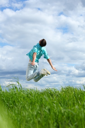 creative freedom: man jump in the blue sky