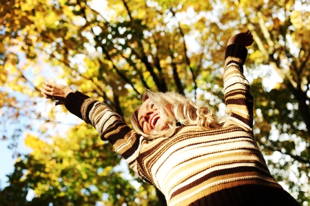 autumn woman hands in the air Stock Photo - 10435902