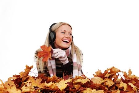 autumn woman listening music in studio Stock Photo - 10435607