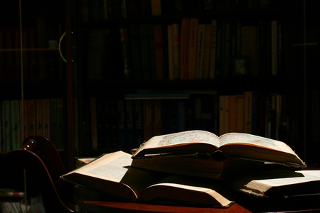 books on table in dark library room Stock Photo - 10462499