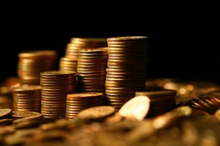 silver coins: golden coins macro close up