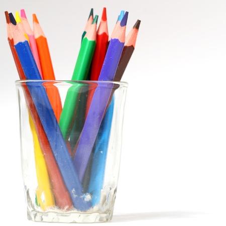 creative tools: matita colore nella macro vetro close up on white Archivio Fotografico