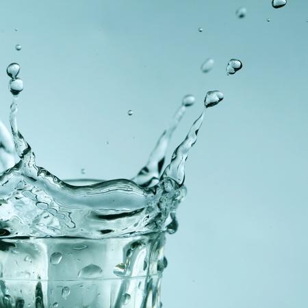 super splash in glass on white background photo