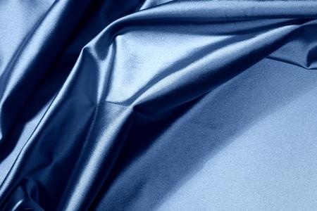 rippled: blue satin background closse up