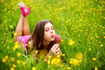 summer woman blow on dandelion Stock Photo - 10469895