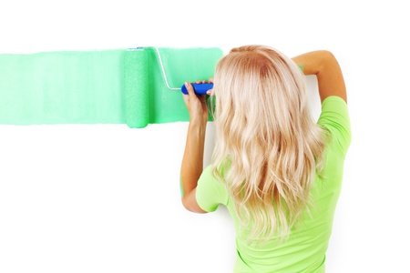 woman paints the wall brush Stock Photo - 10469822