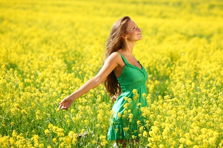 woman on oilseed field close portrait Stock Photo - 10469902