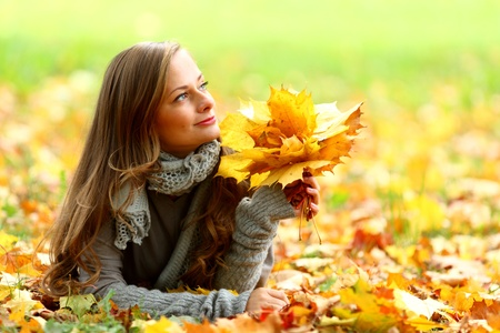 woman portret in autumn leaf close up Stock Photo - 10469873