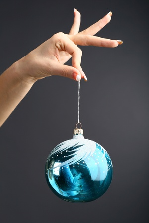 new year  s day: The hand gives the new year ball on a black background