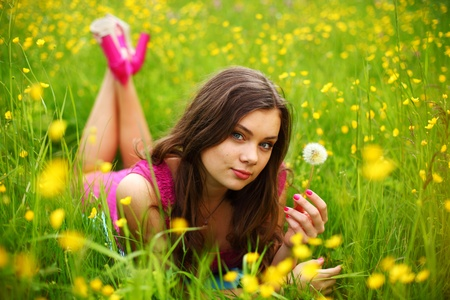 summer woman blow on dandelion  photo