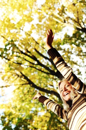 autumn woman hands in the air Stock Photo - 10522886