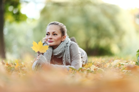 woman portret in autumn leaf close up Stock Photo - 10522869