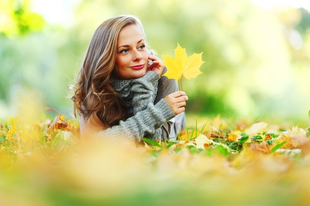 woman portret in autumn leaf close up Stock Photo - 10522838