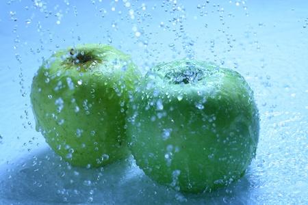 overflowing: apple wash under water wet Stock Photo