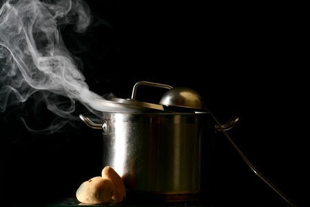 big pan and smoke on black photo