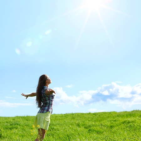 夏の青い空を飛ぶ女性 写真素材