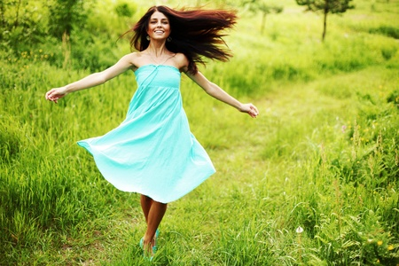 wind dress: nature love woman on flower field Stock Photo