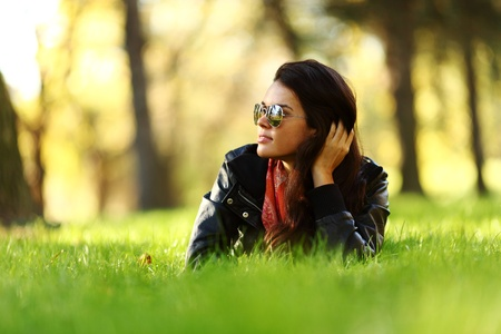 weekend activities: woman lay on green grass in park