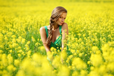woman on oilseed field close portrait Stock Photo - 10548214