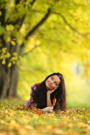 woman portret in autumn leaf close up Stock Photo - 10548048