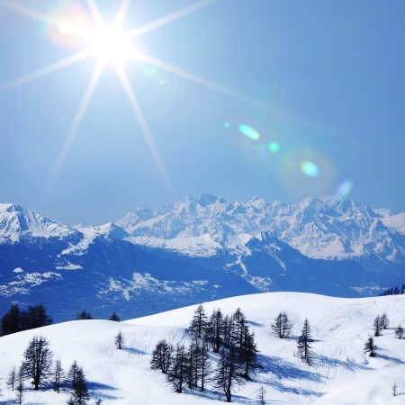 the snowy mountains: top of mountains sun in blue sky