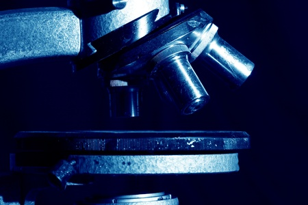 experimentation: microscope close up science background Stock Photo