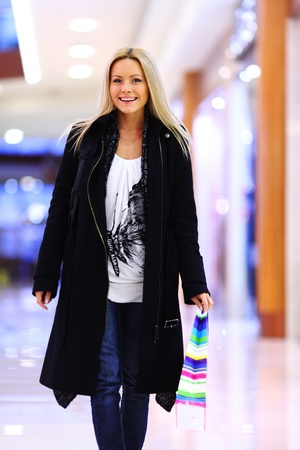 woman in shop center holds the bag in hands Stock Photo - 10555645