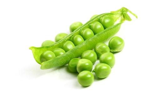 pod: peas isolated on white background macro close up Stock Photo